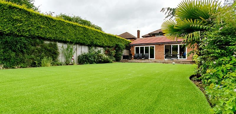 Types of artificial grass - lush green back garden