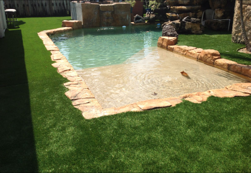 Artificial grass around a pool in surrey