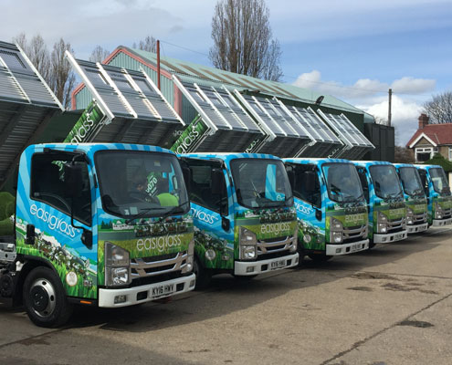artificial grass in kent south - the team's buses parked up