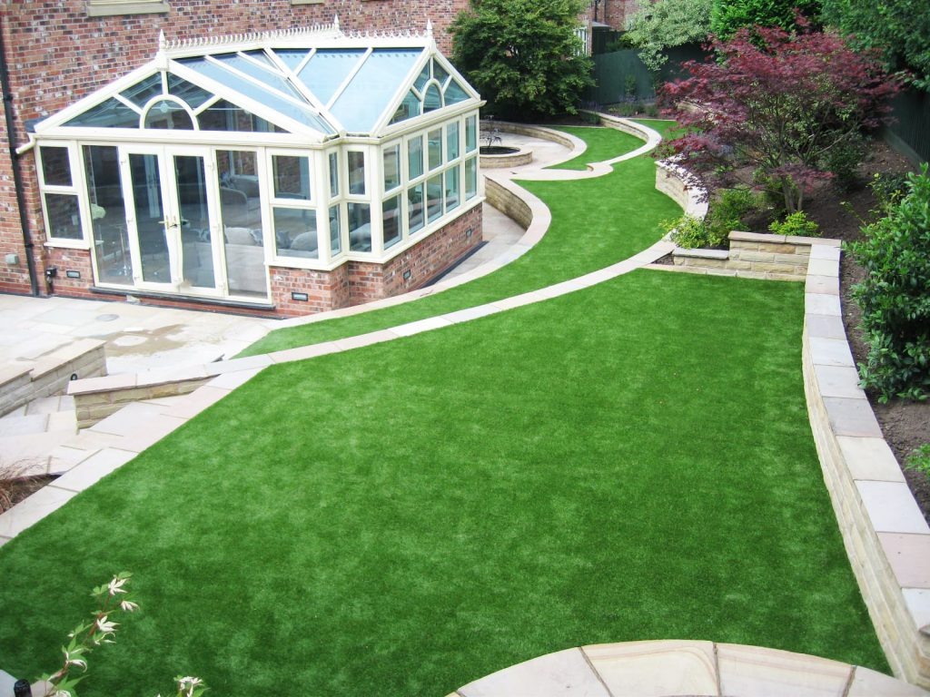large domestic artificial garden - back garden with artificial grass