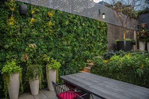 artificial green wall in back garden covering whole wall
