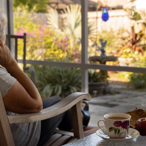 Woman drinking tea and relaxing in garden