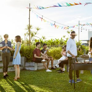 Group of people enjoying a BBQ in the sun