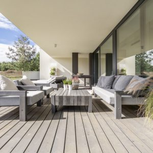outdoor furniture in modern setting with grey tones